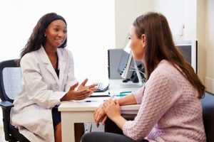 doctor explaining to client about NAD treatment